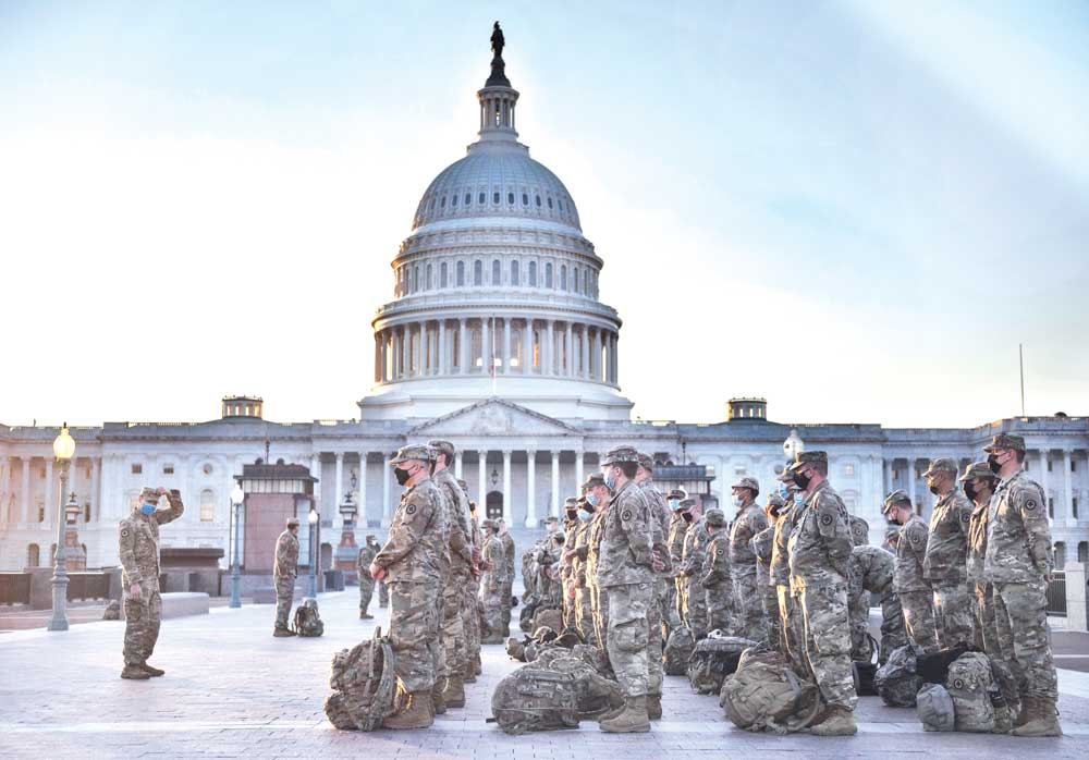 Members of the US National Guard arrive at the US Capitol on January 12, in Washington, DC. The Pentagon is deploying as many as 15,000 National Guard troops to protect Biden's inauguration on January 20, amid fears of new violence.PHOTO: AFP