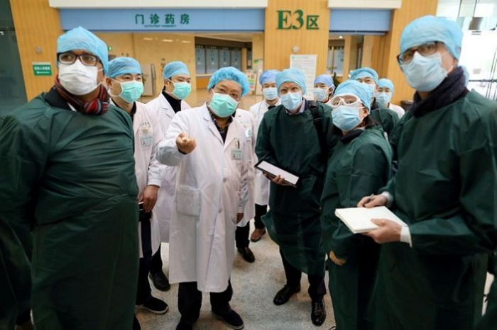 Experts from China and the WHO joint team wearing face masks visit Wuhan Tongji Hospital in Wuhan, the epicentre of the novel coronavirus outbreak, in Hubei province, China February 23, 2020. Photo: Reuters