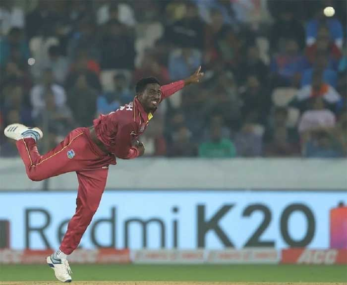 Hayden Walsh bowls in the second T20 between India and West Indies. Photo: West Indies Cricket/Twitter