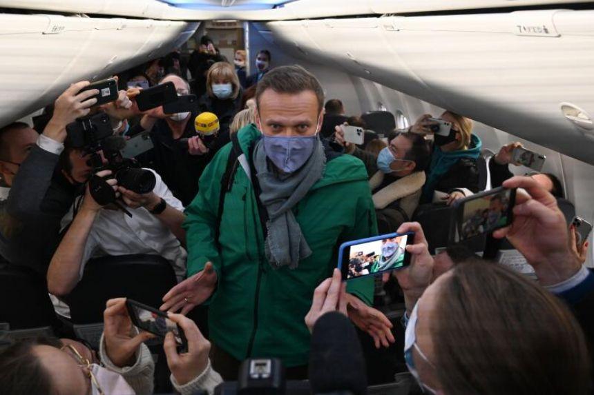 Flight carrying Kremlin critic Navalny lands in Moscow