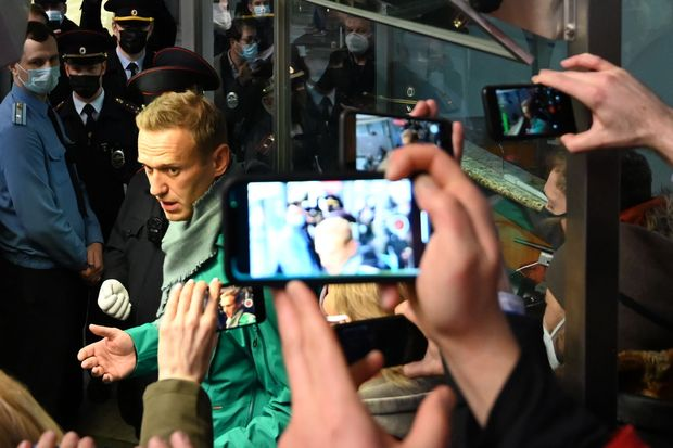 Russian's poisoned leader Navalny held after flying home