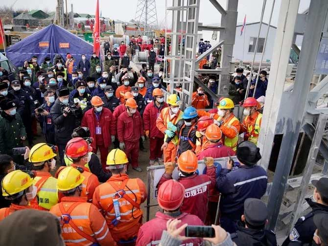 One of the twenty-two Chinese miners is rescued from hundreds of meters underground where they had been trapped for two weeks after a gold mine explosion on Jan. 24, 2021. (AFP)