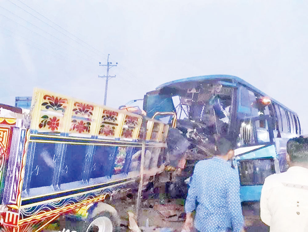 Mangled bus and twisted truck lie on the Dhaka-Tangail Highway