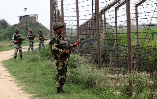 In this photograph taken on August 2, 2012 Indian BSF soldiers stand guard along fencing near the India-Pakistan Chachwal border outpost, some 65 kms north from the north-eastern Indian city of Jammu. Photo: AFP