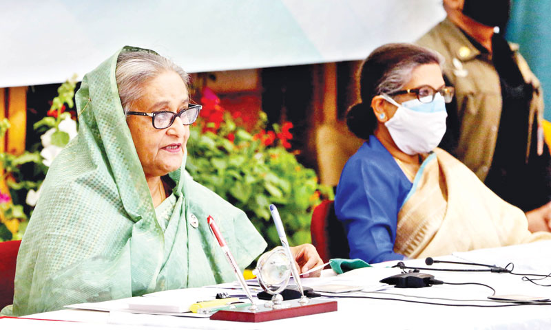Prime Minister Sheikh Hasina accompanied by her sister Sheikh Rehana addressing a press conference at Ganabhaban on Saturday.	PHOTO: PID