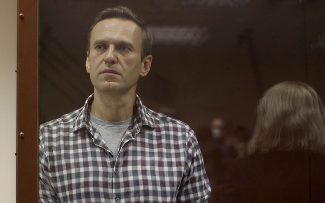 Kremlin critic Alexei Navalny stands inside a defendant dock during a court hearing in Moscow, Russia, Russia February 20, 2021, in this still image taken from video. Photo: Reuters