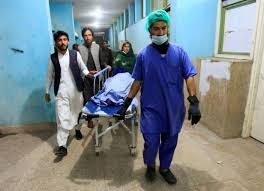 Afghan men transport the body of one of three media workers who were shot and killed by an unknown gunmen, at a hospital in Jalalabad, Afghanistan March 2, 2021. Photo: Reuters