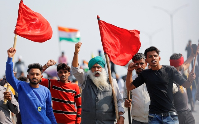 Farmers shout slogans as they take part in a three-hour
