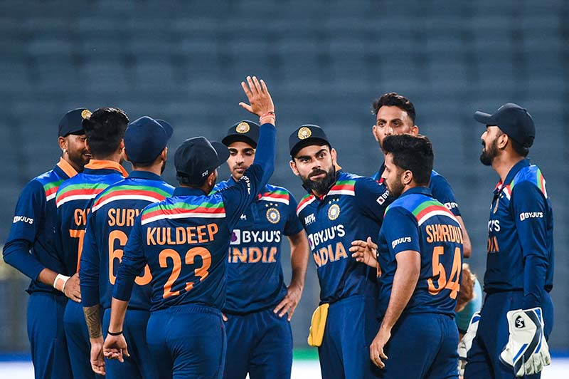 India's players celebrate the dismissial of England's Ben Stokes (not pictured) during the first one-day international (ODI) cricket match between India and England at the Maharashtra Cricket Association Stadium in Pune on March 23, 2021.	photo: AFP