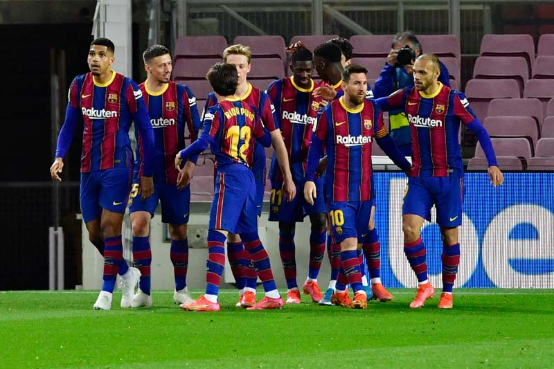 Barcelona's French forward Ousmane Dembele (C) celebrates with teammates after scoring during the Spanish League football match between FC Barcelona and Real Valladolid FC at the Camp Nou stadium in Barcelona on April 5, 2021.photo: AFP