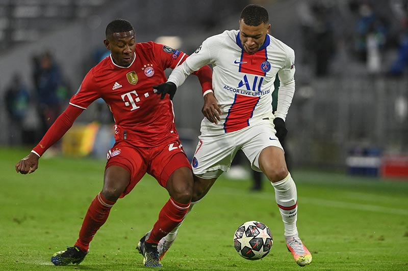 Bayern Munich's Austrian defender David Alaba (L) and Paris Saint-Germain's French forward Kylian Mbappe vie for the ball during the UEFA Champions League quarter-final first leg football match between FC Bayern Munich and Paris Saint-Germain (PSG) in Munich, southern Germany, on April 7, 2021.photo: AFP