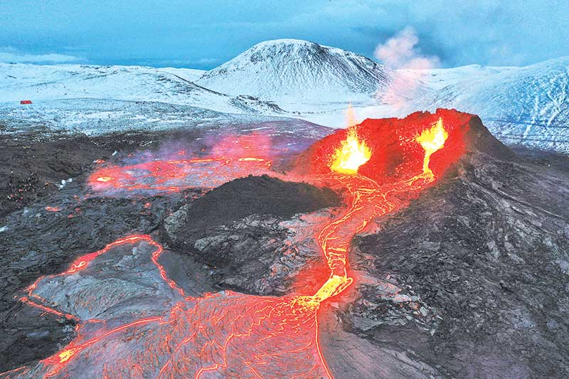 Lava flows from two fissures from a volcano near along the Fagradalsfjall