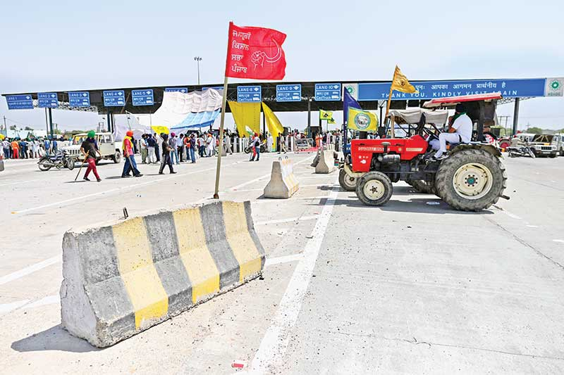 Farmers block the KMP Expressway during a 24 hours roadblock-protest