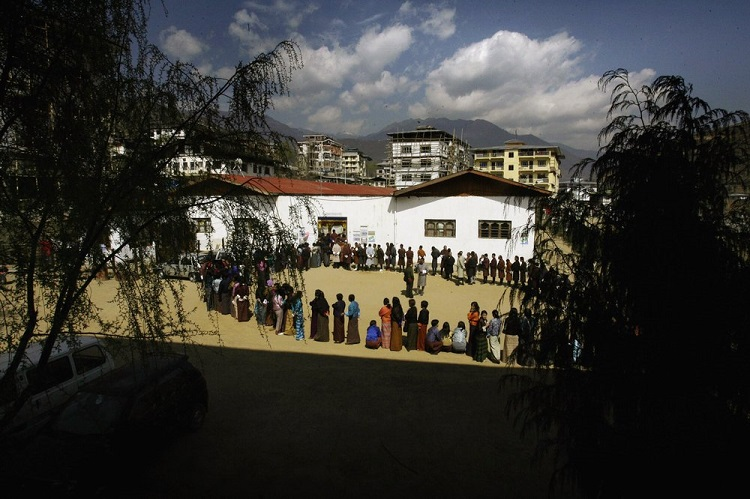 In this March 24, 2008 file photo, Bhutanese people queue up to cast their votes outside a polling station, in Thimphu, Bhutan.Bhutan's COVID-19 vaccination drive was fast from the start. As other countries rolled out their vaccination campaigns over months, Bhutan is nearly done just 16 days after it started. The tiny Himalayan kingdom has vaccinated nearly 93% of its adults. Photo: AP