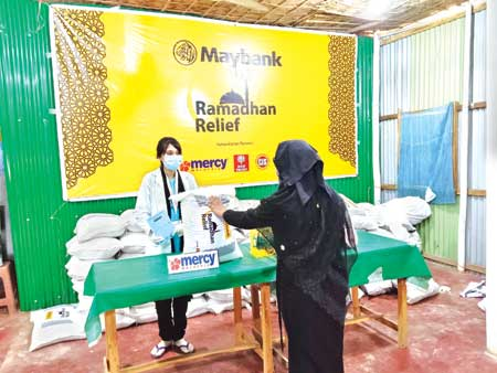 Maybank Islamic distributed food packages among over 2,000 families
