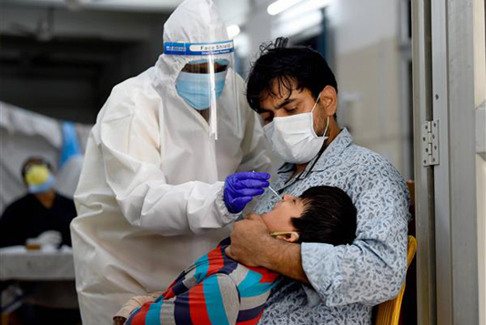 India records 1,61,736 infections, 879 deaths