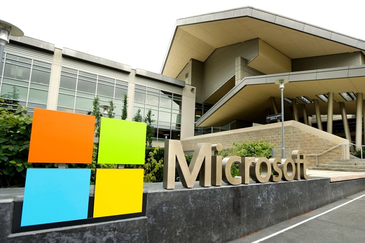 FILE – In this July 3, 2014, file photo, the Microsoft Corp. logo is displayed outside the Microsoft Visitor Center in Redmond, Wash. Microsoft will begin bringing workers back to its suburban Seattle global headquarters on March 29, 2021, as the tech giant starts to reopen more facilities it largely shuttered during the coronavirus pandemic. (AP Photo/Ted S. Warren, File)