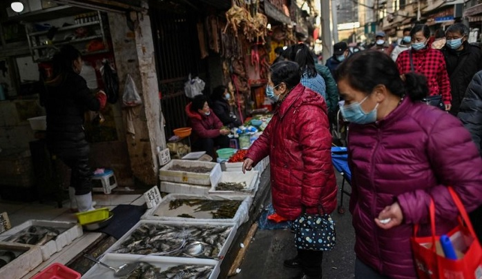 Some of the earliest known cases of Covid-19 had a link to a wholesale traditional food market in Wuhan in China.PHOTO: AFP