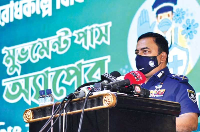Inspector General of Police Benazir Ahmed launches an app for emergency movement pass at Rajarbag Police Lines Auditorium on Tuesday. The citizens of Dhaka will have to collect the movement pass to go outside during the weeklong strict lockdown begins  today (Wednesday). photo : Observer