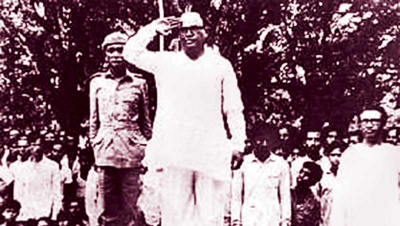 Syed Nazrul Islam, acting president of Mujib Nagar government, taking salute at a guard of honour after the oath taking ceremony of the government on April 17, 1971. File PHOTO