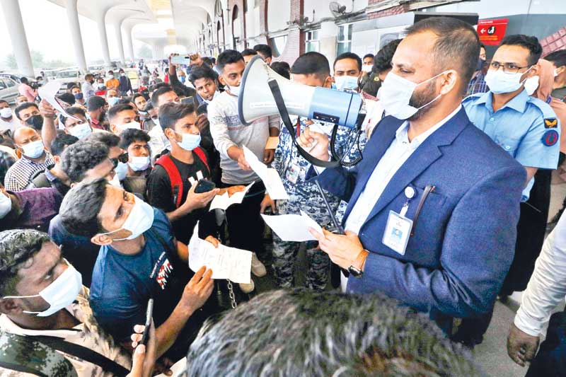 A Biman official addressing stranded the migrant workers at Shahjalal International Airport in Dhaka on Saturday amid the ongoing lockdown in the country.PHOTO: OBSERVER
