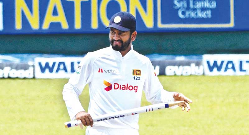 Sri Lanka's cricket captain Dimuth Karunaratne celebrates with the stumps after their victory in the second and final Test against Bangladesh at the Pallekele International Cricket Stadium in Kandy on Monday.photo: AFP