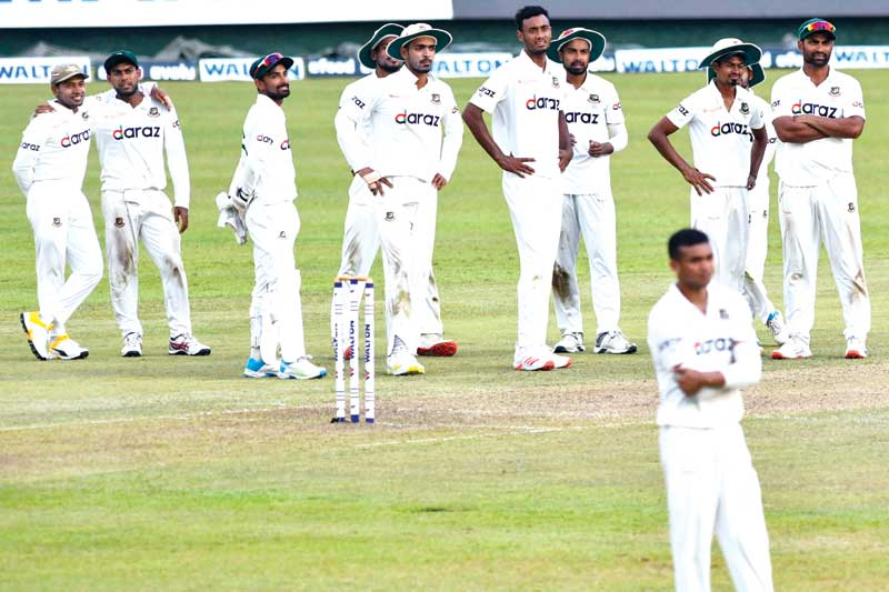 Bangladesh's cricket players look to a screen for a review decision during the first day of the second and final Test cricket match against Sri Lanka at the Pallekele International Cricket Stadium in Kandy on April 29, 2021.photo: AFP