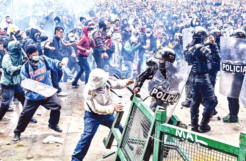 Demonstrators clash with riot police during a protest against a proposed