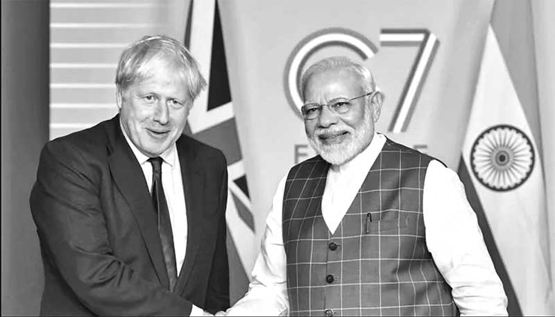 Britain's Prime Minister Boris Johnson meets Indian Prime Minister Narendra Modi at a bilateral meeting during the G7 summit in Biarritz, France August 25, 2019. 	PHOTO: REUTERS