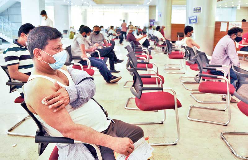 People receiving Oxford-AstraZeneca's Covishield second dose of Covid-19 vaccine at Bangabandhu Sheikh Mujib Medical University vaccination centre in the capital on Tuesday.PHOTO: OBSERVER