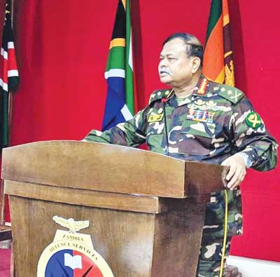 General Aziz Ahmed (inset) delivering speech on Military Diplomacy