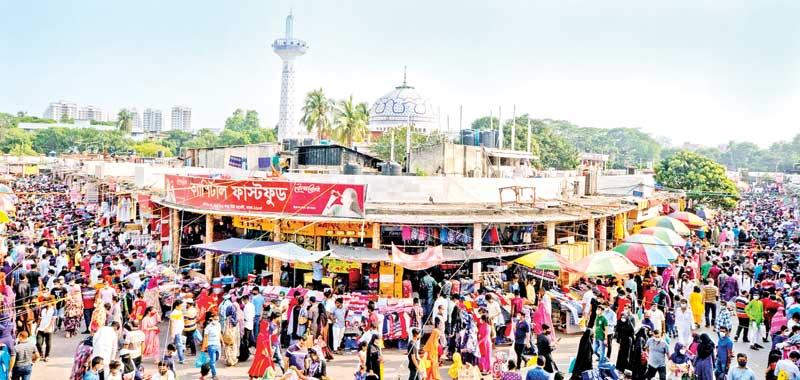 Eid shoppers crowd New Market in the capital, disregarding health guidelines