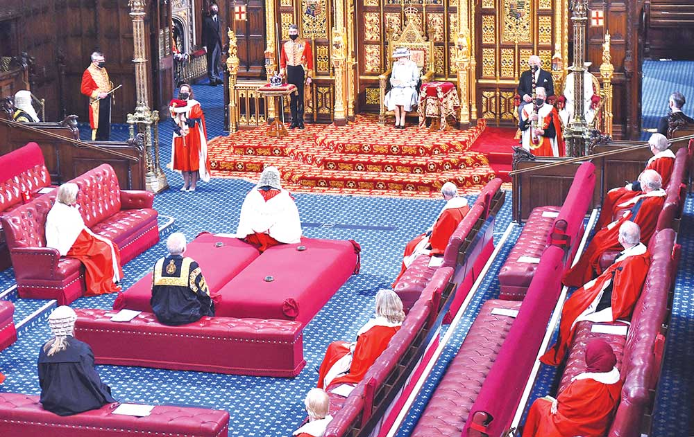 Britain's Queen Elizabeth II reads the Queen's Speech on the The Sovereign's Throne in the socially              distanced House of Lords chamber, during the State Opening of Parliament at the Houses of Parliament in London on May 11, which is taking place with a reduced capacity due to Covid-19 restrictions. The State Opening of Parliament is where Queen Elizabeth II performs her ceremonial duty of informing parliament about the government's agenda for the coming year in a Queen's Speech. AFP