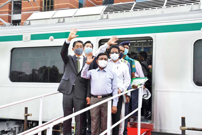 Japanese Ambassador Ito Naoki accompanied by officials boarding the metro rail train for a trial run at Diabari Depot in the capital on Tuesday.PHOTO: OBSERVER