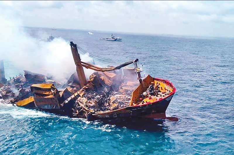 Smoke rises from a fire on board the MV X-Press Pearl vessel as it sinks while being towed into deep sea off the Colombo Harbour PHOTO: REUTERS