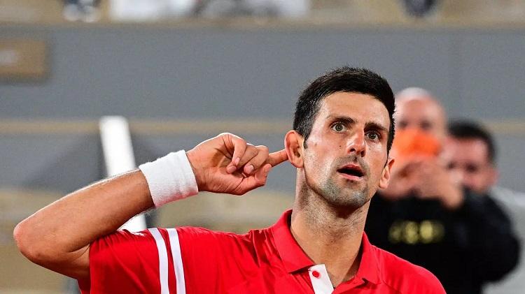 Shout it out loud: Novak Djokovic on his way to victory MARTIN BUREAU AFP