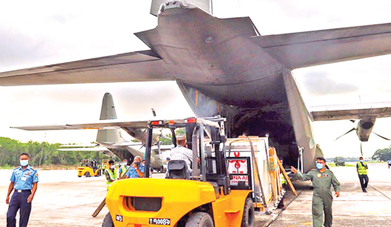 Two C-130 planes of Bangladesh Air Force, carrying six lakh doses of Covid-19 vaccine of Sinopharm as gift from China, land on Bangabandhu Air Base in Dhaka on Sunday afternoon. Earlier, the first instalment of five lakh doses of Covid-19 vaccines from China arrived on May 12. PHOTO: OBSERVER