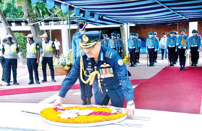 Newly appointed Bangladesh Air Force Chief Air Marshal Sheikh Abdul Hannan places a wreath at the mausoleum of Father of the Nation Bangabandhu Sheikh Mujibur Rahman at Tungipara in Gopalganj on Monday.  photo : ISPR