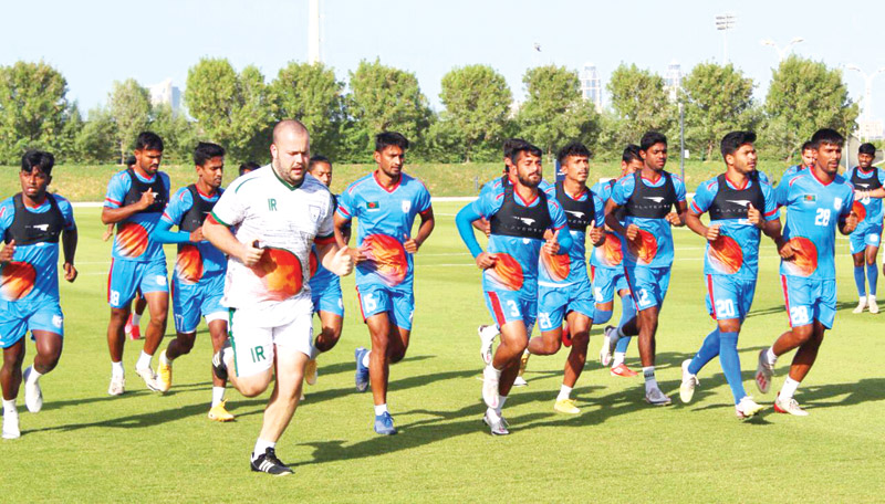 Under the supervision of coaches, Bangladesh national football team practicing at Qatar University Ground in Doha on Monday before the Oman match in the FIFA and AFC joint qualifiers.photo: BFF