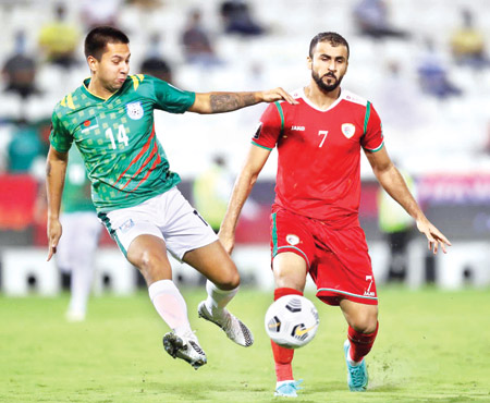 Kazi Tariq trying to take control over the ball in Oman match in the joint qualification round for the FIFA World Cup 2022 and AFC Asian Cup 2023 at night on Monday.photo: BFF