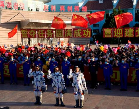 China launches first three-man crew to new space station