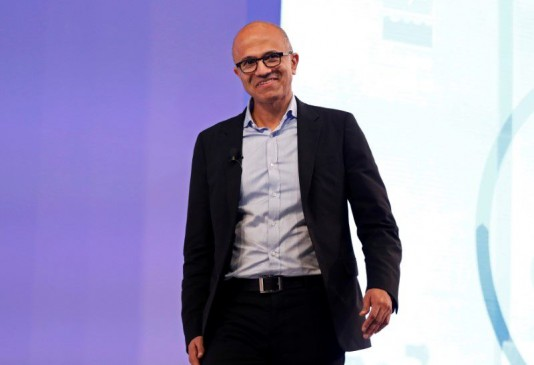 """Microsoft Chief Executive Officer Satya Nadella smiles during his conversation about his latest book """"Hit Refresh"""" during an event in New Delhi, India, November 7, 2017. Photo: Reuters"""