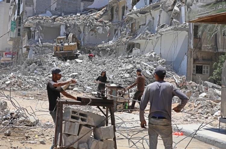 The Israeli onslaught killed at least 257 Palestinians, including 66 children. Photo: Al Jazeera/Ashraf Amra