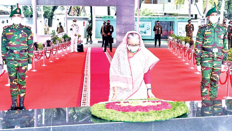 Prime Minister and Awami League President Sheikh Hasina laying wreath at the portrait of Bangabandhu Sheikh Mujibur Rahman at Dhanmandi 32 on the occasion of the 72 Founding Anniversary of the party on Wednesday. PHOTO: PMO