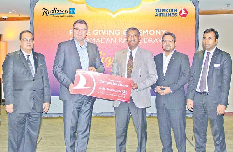Prize distribution winner of the Ramadan Iftar Raffle Draw
