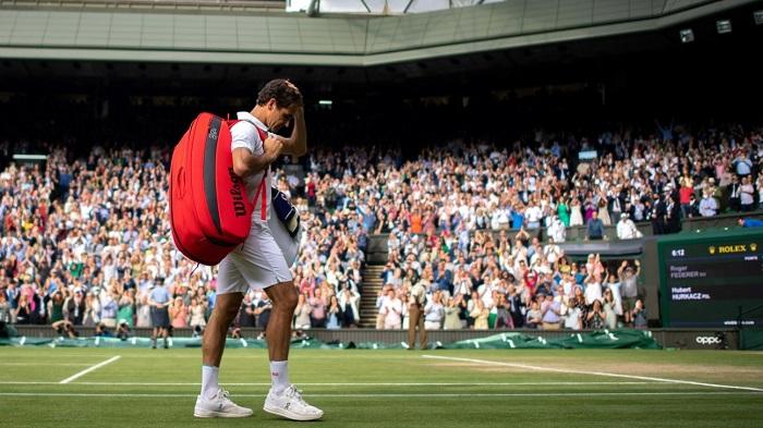 Switzerland's Roger Federer leaves Centre Court after losing his quarter final match against Poland's Hubert Hurkacz. Photo: Reuters