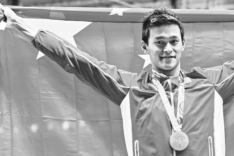 (FILES) This file photo taken on August 8, 2016 shows China's Sun Yang posing with his gold medal on the podium after he won the men's 200m freestyle final during the swimming event at the Rio 2016 Olympic Games at the Olympic Aquatics Stadium in Rio de Janeiro. China are missing banned superstar Sun Yang but they will take a record team to Tokyo seeking a strong showing with their own Olympics just months away.photo: AFP