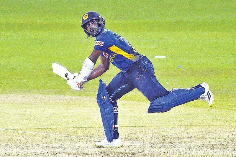 Sri Lanka's Chamika Karunaratne plays a shot during the first One Day International (ODI) cricket match between Sri Lanka and India at the R.Premadasa Stadium in Colombo on July 18, 2021. photo: AFP