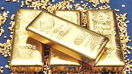 Gold prices hover near one-week low as dollar gains