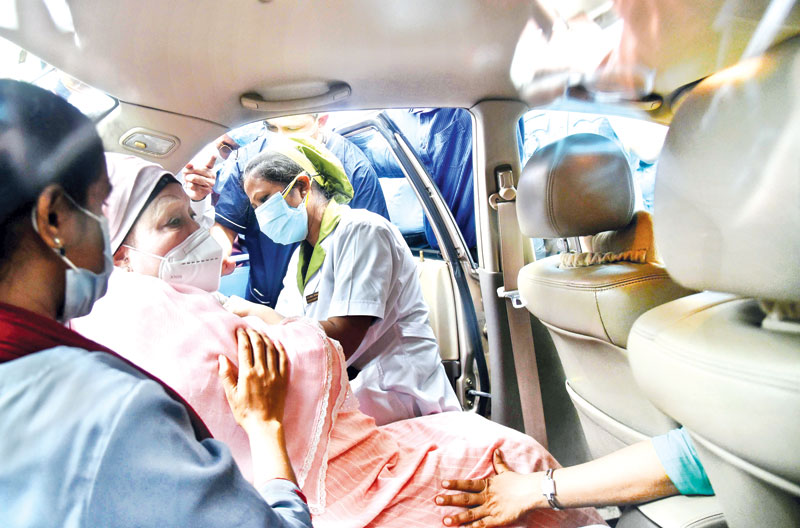 BNP Chairperson Khaleda Zia receives Covid-19 vaccine at National Gastroliver Institute and Hospital at Mohakhali in the capital on Monday.photo: Observer